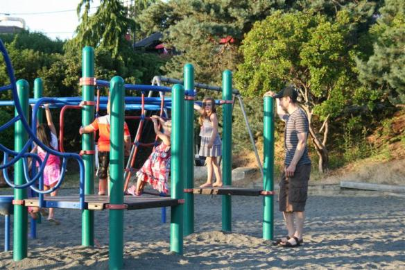 A watchful dad in the playground.