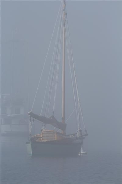 sailing vessel ' lucky ' , out  in the fog.