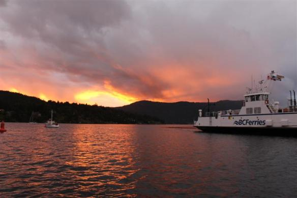 beautiful , evening sky, brentwood,mill bay ferry just coming in.