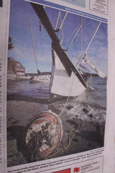 One of the boats, stranded on shore in Tsehum harbour,buoy and all.