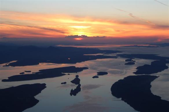 Sunset over the Gulf islands, Clam bay, Porlier pass, in the distance, Dodd narrows.