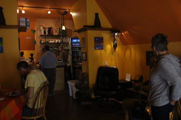 the inside of the caffe has a warm ambience, paited in warm colors.