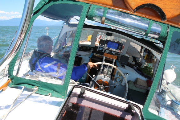 skipper at the wheel