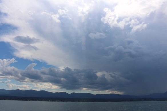 A thunderstorm, slowly forming above the mountain ridge.